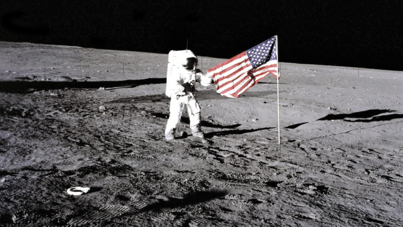 U.S, Flag On The Moon, Apollo 12 Astronaut Charles 'Pete' Conrad Stands Beside The U.S, Flag After It Was Unfurled On The Lunar Surface On Nov, 19, 1969, Footprints Made By The Crew Can Be Seen In The Photograph. (Photo By Encyclopaedia Britannica/UIG Via